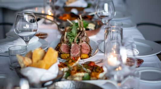 Intimate,Fine,Dinning,With,Lamb,Chops,And,Table,Setting