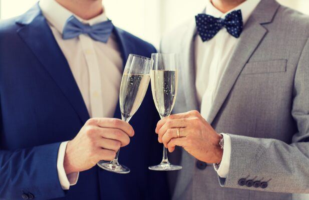 Close,Up,Of,Male,Gay,Couple,With,Champagne,Glasses